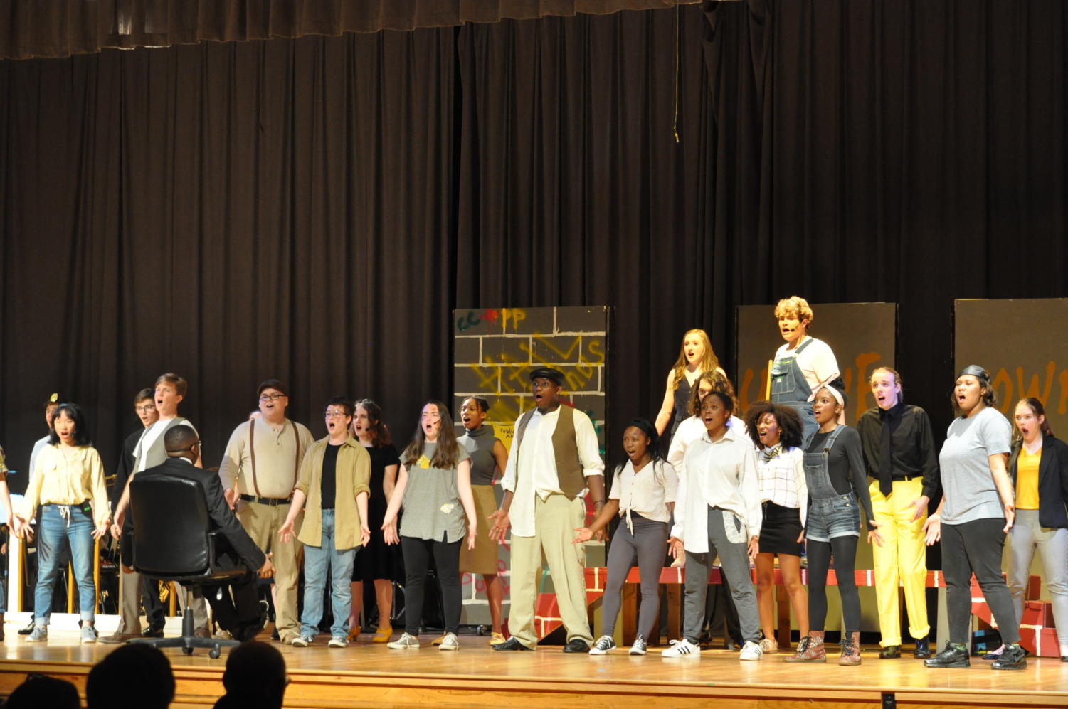 Urinetown members pose during their first dance number.