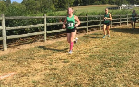Mary Hatley (11) and Emma Shadow (12) push through the heat at the AF Bridges Invitational. Shadow finished first on the team, and Hatley finished fourth