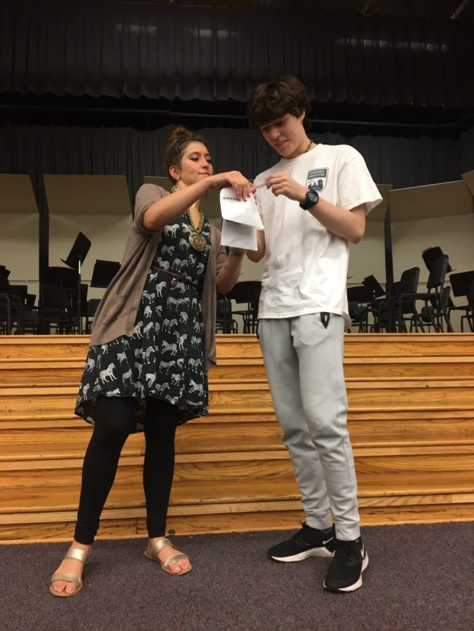 Lena Black instructs Blake Shirley (10) in an acting exercise designed to test the actor's ability to lean into a character. Black is an alumnus of White Station and was a member of the Thespian Society herself.