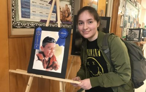 Anahis Luna (11) is with her watercolor piece, which won first place in the Midsouth Art Fair competition. The piece depicts Luna's younger cousin.