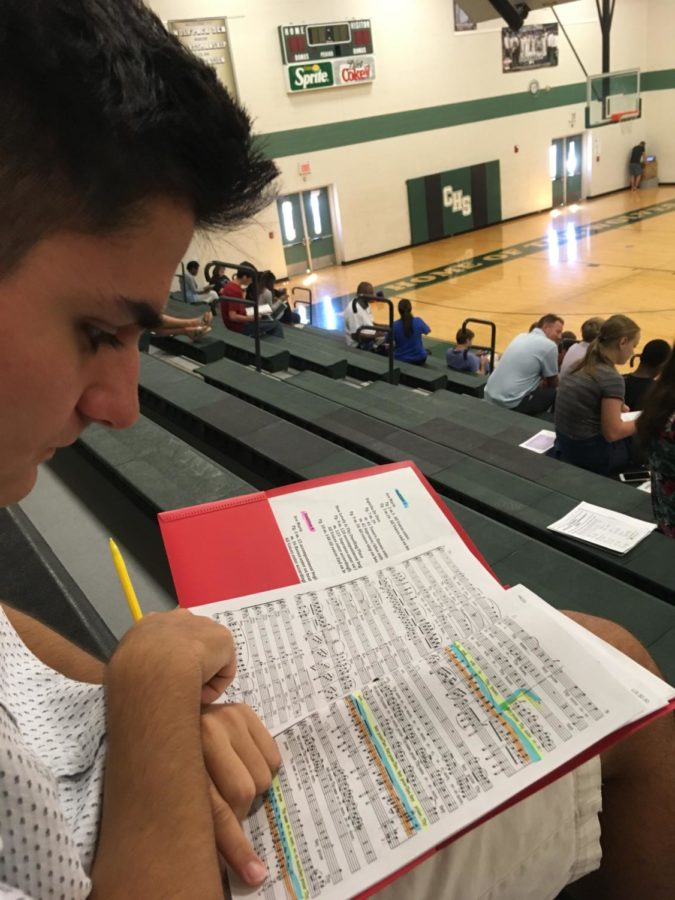 Gino Giorgianni studies his music prior to his audition at Cordova High School. Giorgianni qualified for the All-Southwest Honor Choir along with others.
