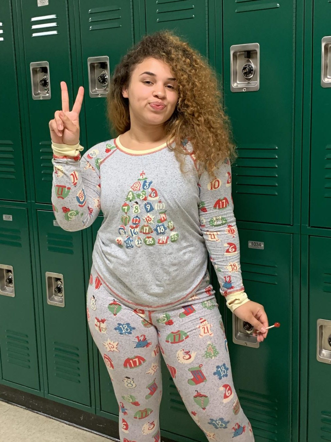 MaLiyah Hughes (12) posing in her Christmas themed outfit.
