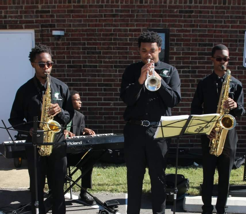 "Myles Robinson (12) on alto saxophone, Daniel Harvey (12) on piano, Jaden Ross (12) on trumpet, and Joshua-James Claybon on tenor saxophone play Lee Morgan's ""Ceora"" for first responders in downtown Memphis. This song was one of many chosen by the players themselves to perform."