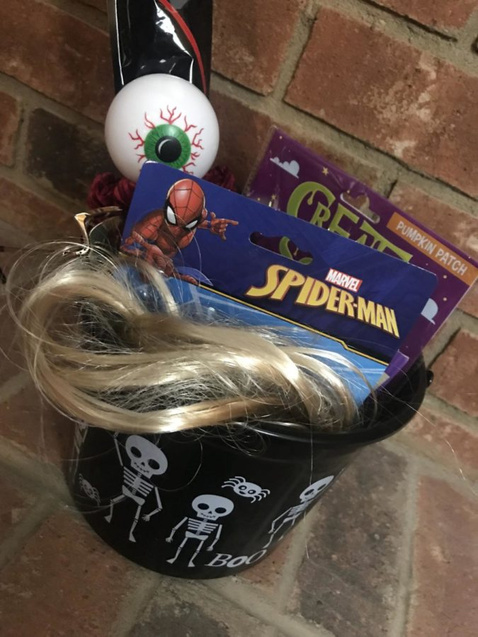 Spooky baskets consisted of Halloween themed trinkets, sweets or anything else E-Board members thought each other would like. This basket was given to Justin Kouch (12), President of E-Board, by Ivy Qui (11), Commissioner of Publicity.