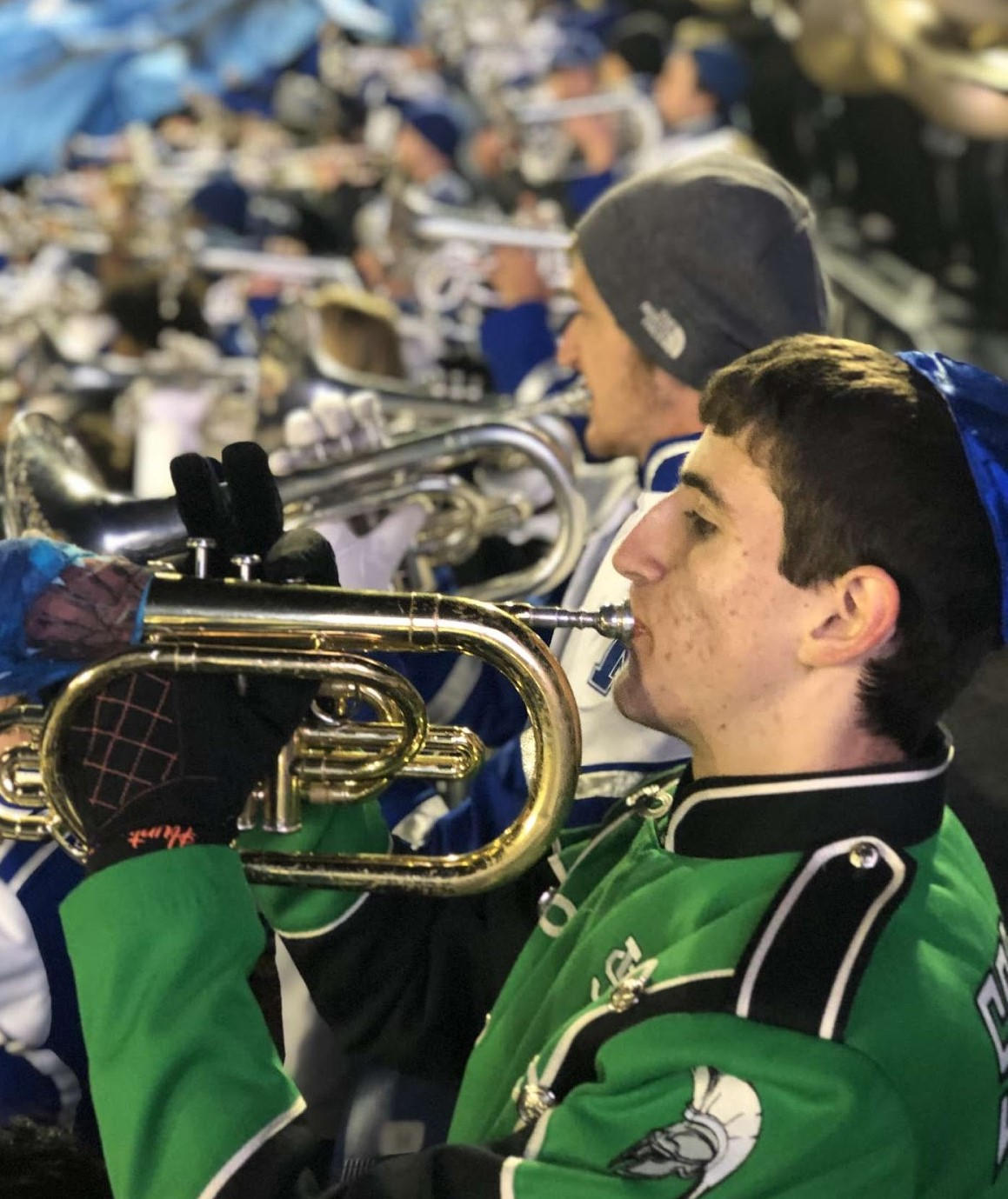 Cody Hunter performs alongside fellow mellophone players from the University of Memphis marching band. Cody attended his third Band Day this year and learned new skills from U of M students, despite being a senior.