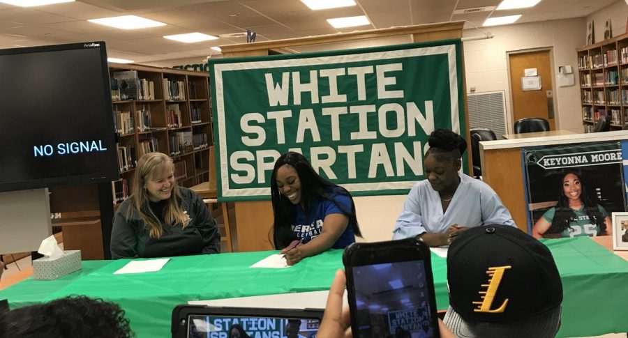 With her coach on her right and her mother on her left, Moore signs the official papers, securing her future as a Mountaineer. She will trade in her number 25 jersey for a new one in Berea's blue and white colors
