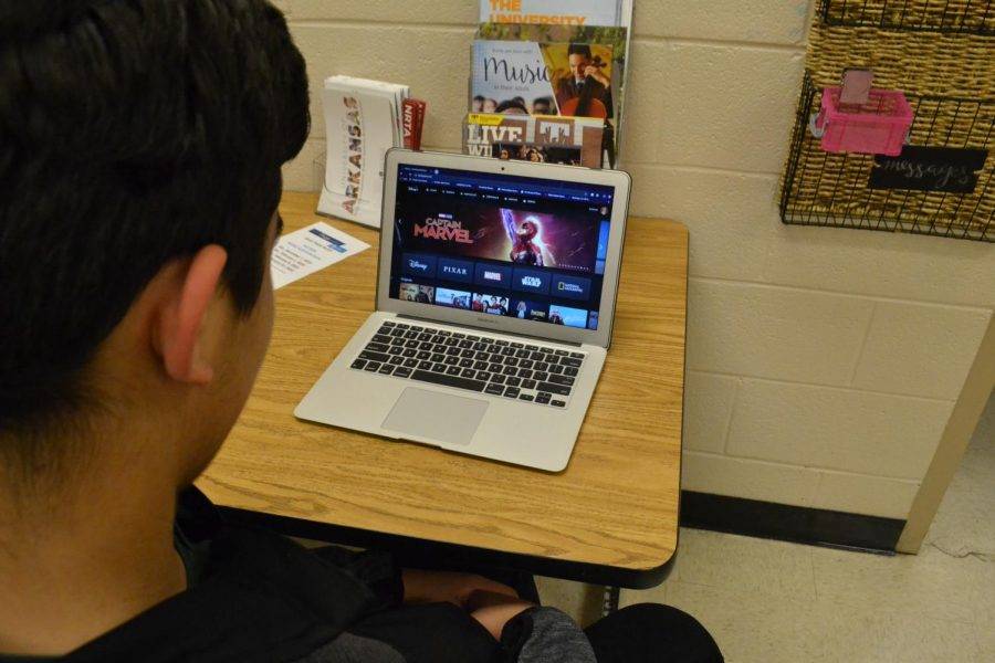 Antonio Villareal (11) browses Disney Plus for viewing options. The platform boasts over 8,500 programs with plans for expansion in the future; as of now, Disney+ encompasses original Disney channel shows and movies, Marvel, National Geographic, ESPN, Pixar and Star Wars.