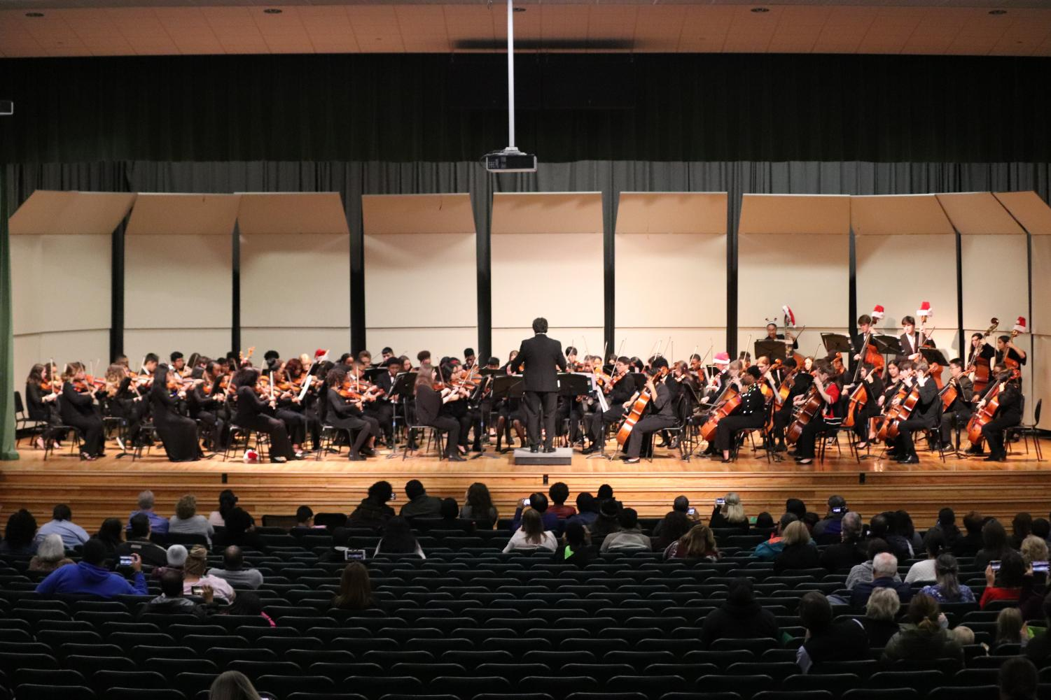 """The Intermediate Orchestra and Advanced Honors Orchestra combined forces to play two traditional holiday finale pieces. They performed """"We Need a Little Christmas"""" as well as a """"Mother Ginger"""" from the play """"The Nutcracker."""""""