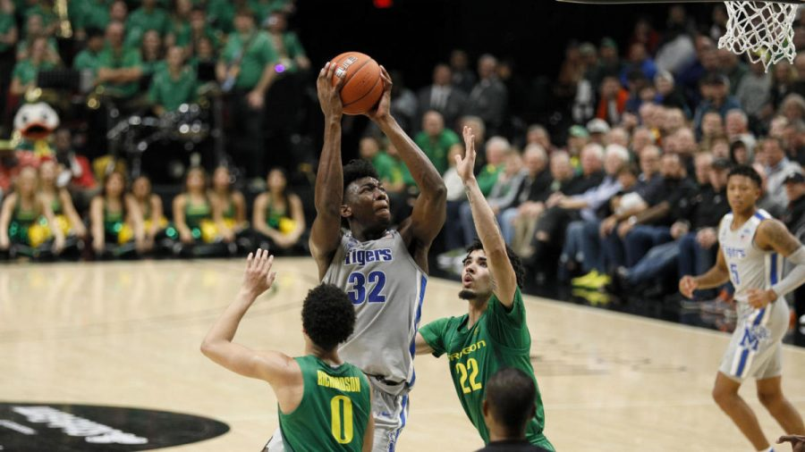 James Wiseman attempts a shot over two Oregon players on Nov. 12. Wiseman and the Memphis Tigers fell to Oregon, 82-74, in what would be Wiseman's last game before complying with his declared ineligibility.