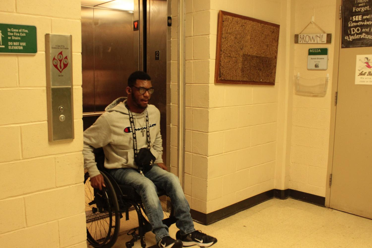 Kobe Cunningham (12) exits a main building elevator in his wheelchair. There are elevators, lifts and ramps located all around White Station that make the school handicap-accessible.