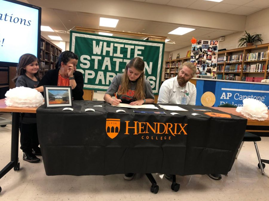 Annie Kannady, surrounded by her family, officially signs to Hendrix College. She will be joining the Warriors' Women's Swimming and Diving Team in the fall.