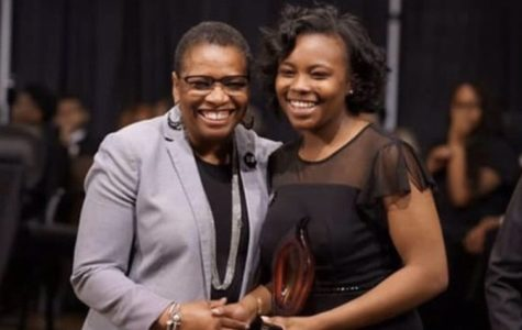 Marissa Pittman (12) shakes hands with Bathsheba Sams, the Senior Vice President of Human Resources for International Paper. The Keeper of the Dream award was established by the National Civil Rights Museum in honor of Dr. Martin Luther King Jr.