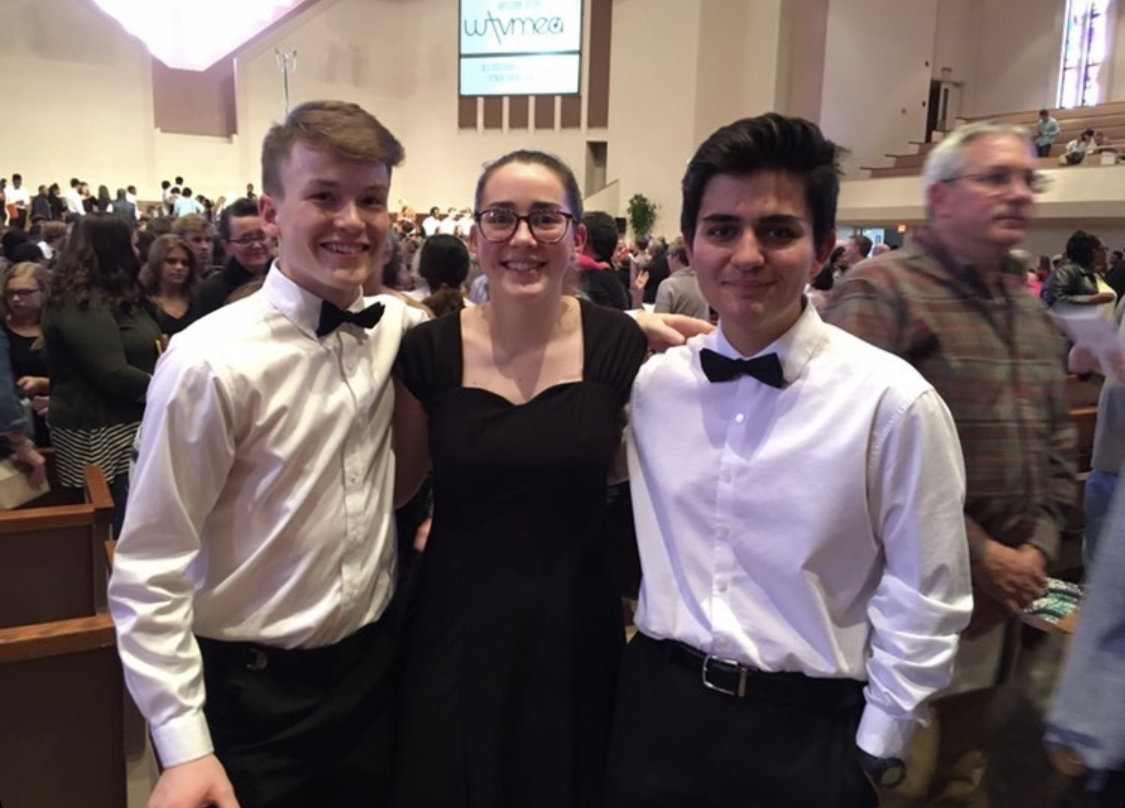 White Station singers Charlie Huebner(11), Maddie Hitching(11), and Gino Giorgianni(11) pose after performing  with the All-West honor choir.