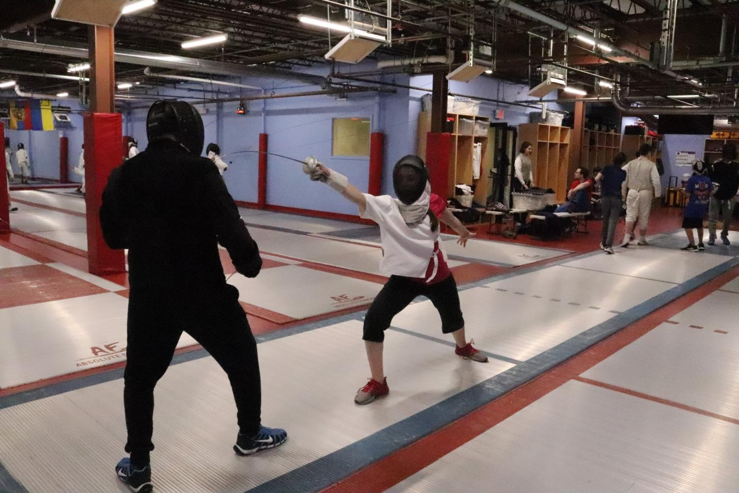 Mya Schroder (11) spars with coach Sergey Petrosyan at a Raptors practice on Thursday, Nov. 21. Schroder has attended the Raptors club at MUS since late August to improve her fencing.
