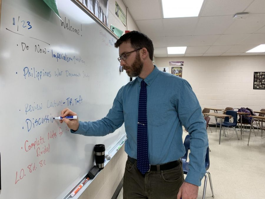 Writing+the+day%27s+agenda+on+the+white+board%2C+Kyle+Tingley+prepares+for+his+classes+of+the+day.+Joining+WSHS+at+the+beginning+of+the+second+semester%2C+Tingley+teaches+Duel+Enrollment+World+History+to+upperclassmen+students.