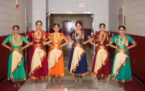 Tanya Prahalathan (10), Shivani Menon, Minnu Reddivari (10), Elina Salian (10), Sharika Sivakumar, and Arya Rajesh (9) pose at an event for the Tamil Association. These Bharatanatyam dancers meet for practice once a week and perform together several times a year.