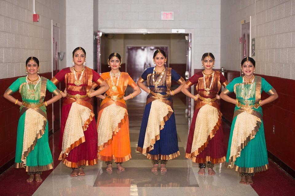 Tanya Prahalathan (10), Shivani Menon, Minnu Reddivari (10), Elina Salian (10), Sharika Sivakumar, and Arya Rajesh (9) pose at an event for the Tamil Association. These Bharatanatyam dancers meet for practice once a week and perform together several times a year.