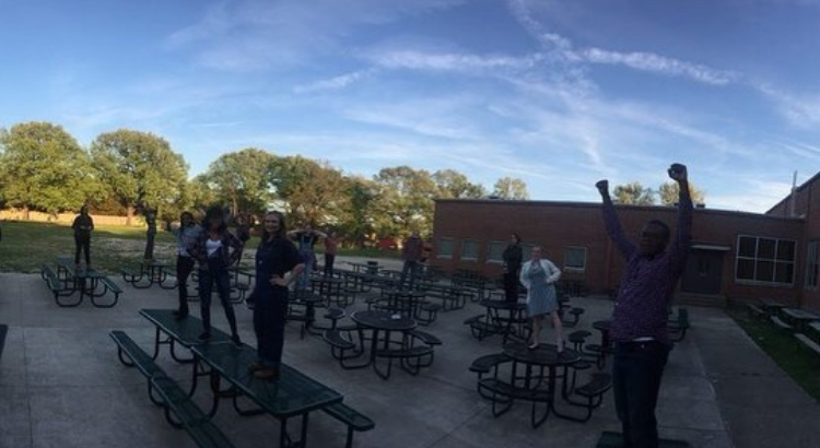Thespian society members stand on the picnic tables outside the cafeteria and scream. This is a ritual that they do before every performance to let their nerves out.