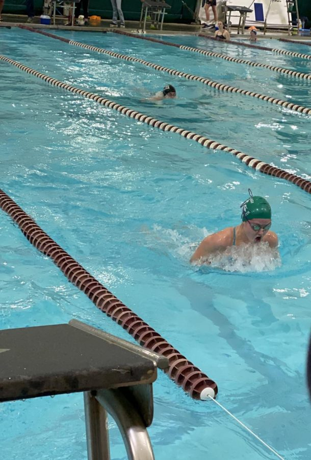 Annie Kannady (12) swims the 50 breaststroke race during the 2020 county championship meet on Saturday, Jan. 25. The meet lasted the entire day, starting with the qualifying races in the morning and ending with finals in the evening.