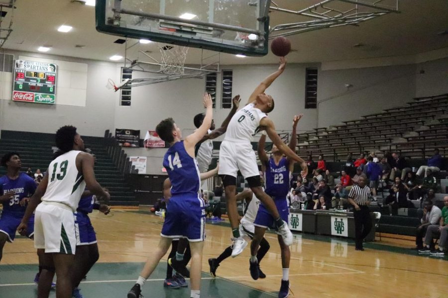 Kolby Hilson (12) attempts to dunk the basketball during the varsity game versus the Harding Academy Lions on January 9, 2020. The boys team won 69-59. The girls team lost 60-50.