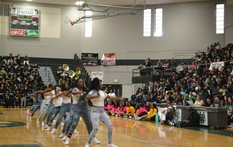 "The Showstoppers perform at the basketball homecoming pep rally after weeks of preparation. For the last event of the year, they stepped to ""Ain't my fault,"" ""Hot now,"" ""Chop style"" and ""Blow the whistle."""