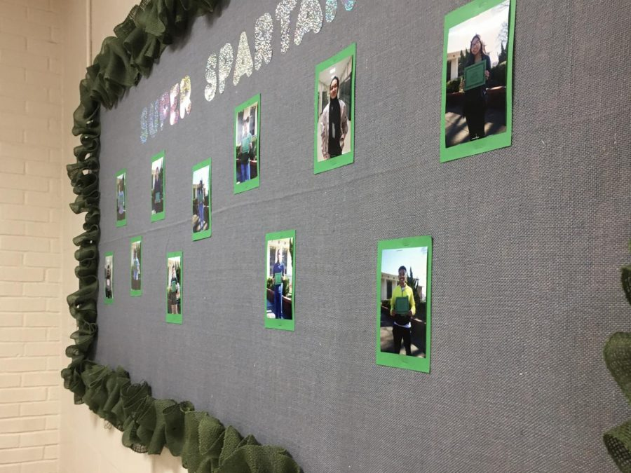 The+photos+of+the+Students+of+the+Month+are+stapled+to+a+green+and+grey+poster%2C+with+holographic+letters+depicting+%22Super+Spartans%22.+Kingston+Barber+%289%29%2C+a+student+of+the+month%2C+has+his+photo+on+the+wall+along+with+ten+other+students.+%E2%80%9CI+get+along+with+the+teachers+pretty+well%2C+I+listen...I+do+my+homework%2C+and+I+have+good+grades.%E2%80%9D+Kingston+Barber+%289%29+said.++