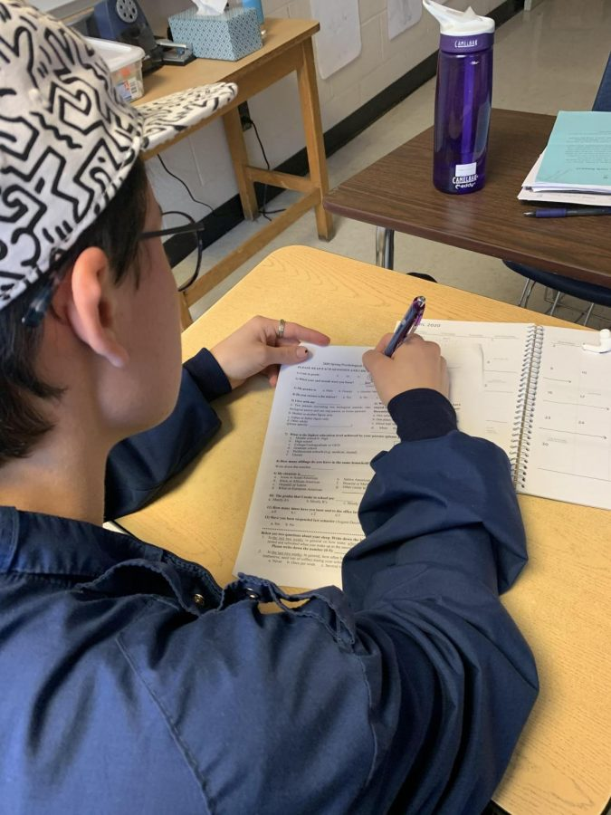 Cameron Leith(12) takes a comprehensive, 60 question survey conducted by U of M graduate principal graduate researchers Xu Jiang and Allyson Topps. The survey is being used to find how psychological strengths predict better social-emotional well being in adolescents.
