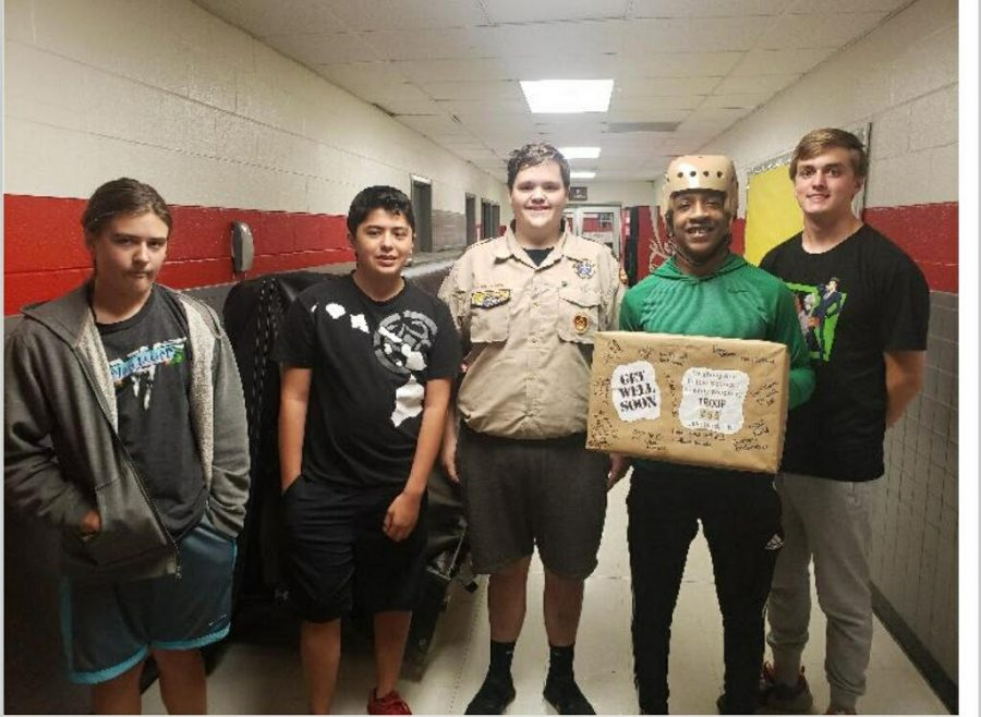 Pictured left to right: Scouts Quillen Huffman, Levi Fagans, Brian Rich, Tylan Williams and Drew Davis. Since a near fatal bus accident last year, Williams has undergone multiple cranial surgeries and months of rehabilitation on the road to recovery.