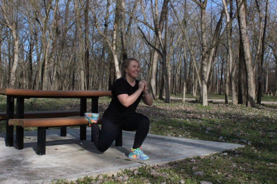 Spanish teacher Emilee Chesnut smiles as she performs split squats on a sunny Saturday afternoon. Chesnut, along with other teachers, chooses to dedicate her few hours of free time to work out.