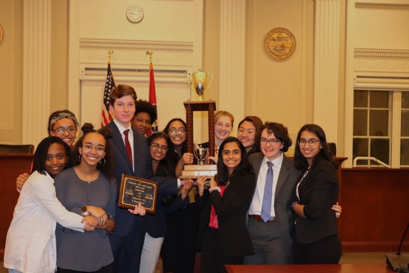 The+Mock+Trial+team+poses+for+one+final+picture+before+leaving+for+state+competitions.+Their+dedication+has+landed+the+team+another+city+championship%2C+and+the+potential+for+more.