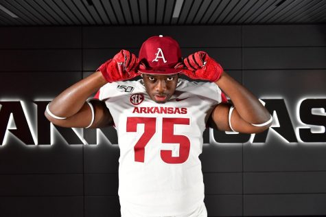 Ray Curry (12) poses on his visit to Arkansas earlier this year.  Curry is one of a few White Station athletes that has gone through the college recruitment process this year.