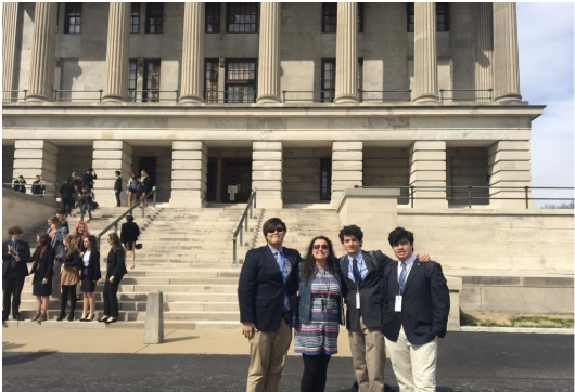 From left to right, Justin Kouch (12), Rachel Kannady, Itamar Almalem (11) and Seth Khokar (11) stand in front of the state capital building after the closing ceremony. After a one year hiatus, Youth in Government is back in full throttle, ready to change the government.