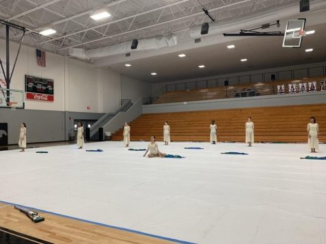 Poised and ready, the White Station winter guard solemnly anticipates the first beat of the music. This was the team