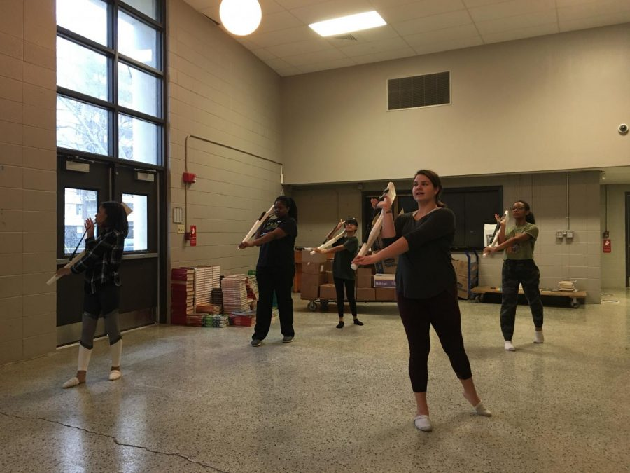 The White Station winter guard learns a new rifle toss in preparation for the upcoming competitive season. The team has been active since 2018.