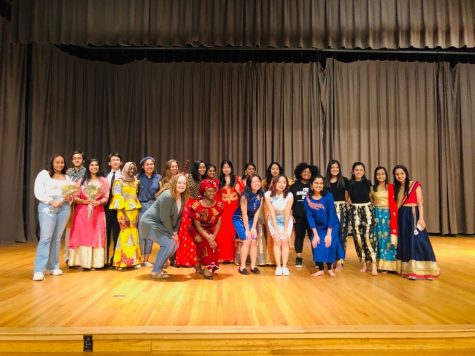 Fusion performers group together after the program. There were a variety of performances, including dance and violin.