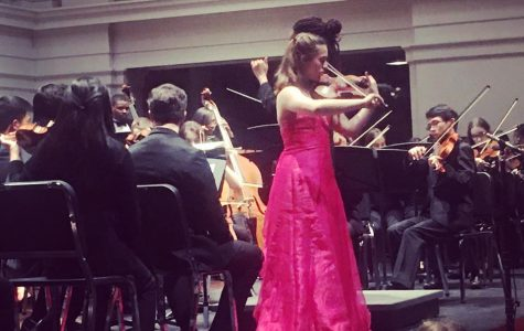Soloist Zoe Wolfe fingers her way through the intricate and emotional notes of the Lalo violin concerto in concert. Months of preparation went into the performance, including Wolfe's participation in the Memphis Youth Symphony's concerto competition, which won her spot in the concert season.