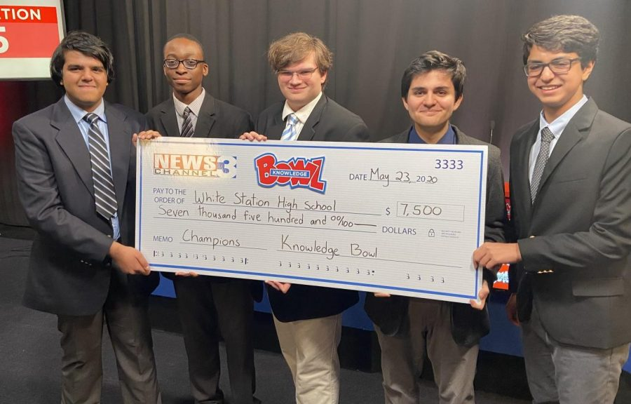 Aryaman Jaiswal, Gideon Kpurubu, Dominic Reynolds, Gino Giorgianni and Raj Gosain hold the check awarded to them as the Knowledge Bowl champions. The team went undefeated for the entire 2020 season.