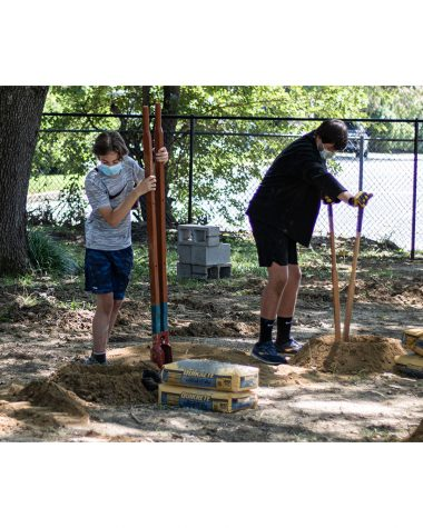 Axel Miller (9) and Jordan Kirby (9) dig holes in preparation for wooden posts for an obstacle. Over the course of five days, volunteers came and helped construct the Jerry Hiemer JROTC Leadership Course at WSHS.