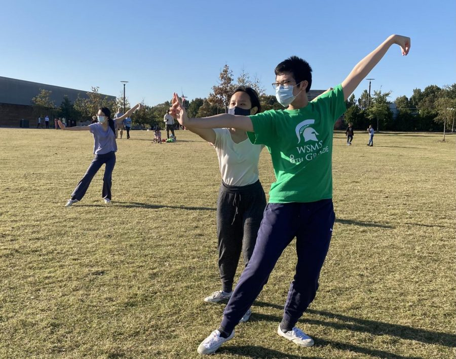 Molly Yuan adjusts Allen Xie's cat stance during in-person practice at Shelby Farms Park. Reviewing stances, practicing kicks and learning different forms are usually on Wushu Transcend's weekly agenda.