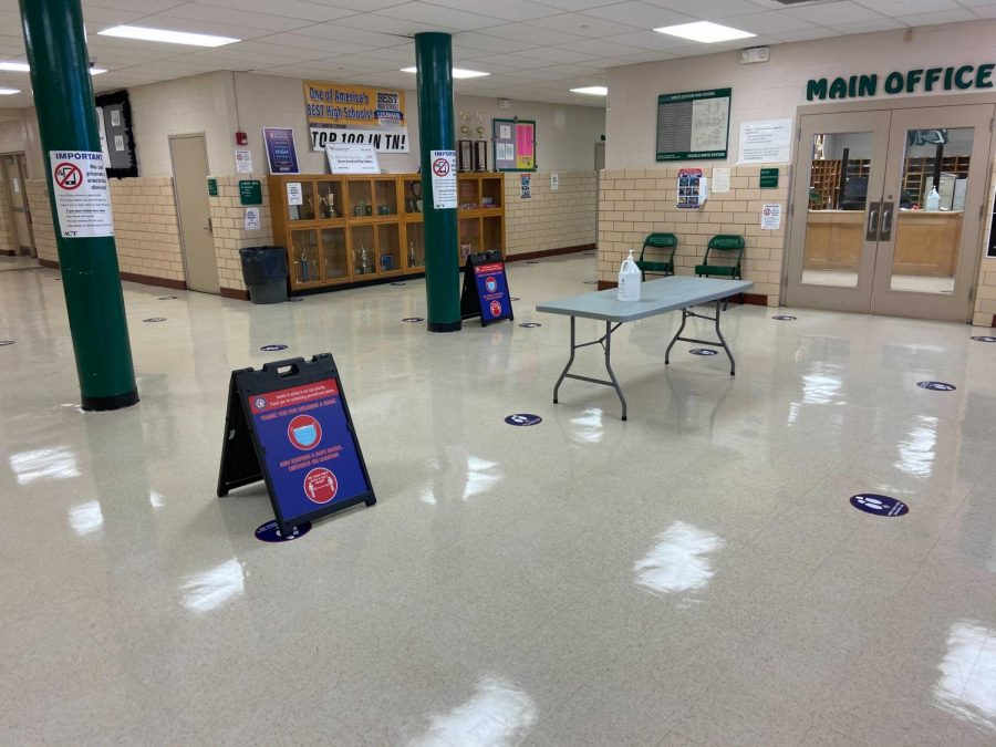 Teachers and Administration prepare for a populated school day by placing socially distanced markers in the hallways and pathways around the school. After being vacant for months, this grand entrance could be seeing visitors soon.