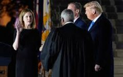 Amy Coney Barrett is sworn in as an Associate Justice on the Supreme Court by Chief Justice John Roberts. Her personal and political beliefs have been deemed controversial by many, and her role as the first politically conservative woman on the court makes history.