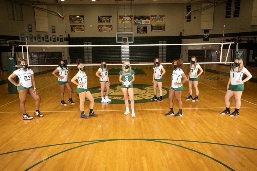 Masked up, the volleyball team stays strong through uncertain times. While their season may look different from normal, they maintain optimism.