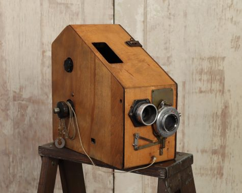 The school day cameras used by Brys Portrait Studio in the 1950s boasted simple technology: limited mobility, a large outer shell and a long line of film within the interior. On the side of the cameras, washers attached to string would be held in front of the lens by the photographer to artificially focus the camera.