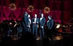 "Joseph Powell, pictured far right, sings in a sextet in the Memphis Symphony Chorus for the Magic of Memphis Holiday Concert, with the conductor of the Symphony, Robert Moody, singing in the middle. They were singing ""The Rose"" as performed by Bette Midler."