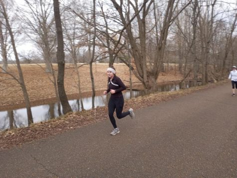 Jillian Maxwell (12) runs in her first half-marathon. She has been running for fun since the sixth grade.