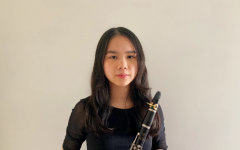 Sandy Nguyen (11) poses for her All-West festival audition tape. She is pictured with the clarinet and has played for six years.
