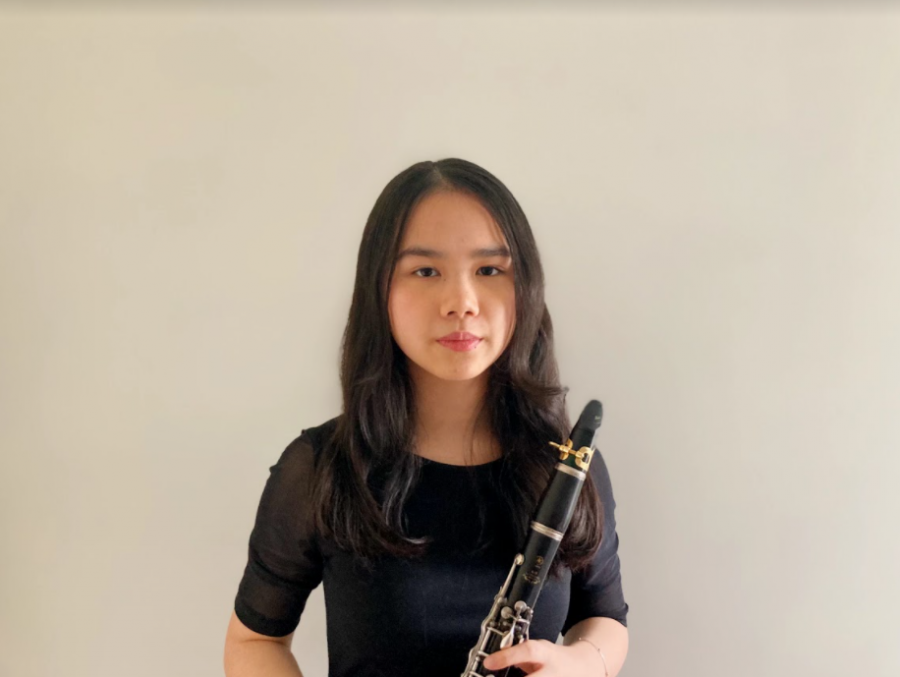 Sandy+Nguyen+%2811%29+poses+for+her+All-West+festival+audition+tape.+She+is+pictured+with+the+clarinet+and+has+played+for+six+years.