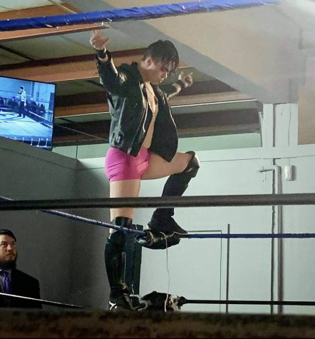 Jared Rawlings (10) makes his entrance into a championship match — the biggest event of his professional wrestling career so far. Posing on the top rope is one of many ways to make a powerful first impression.