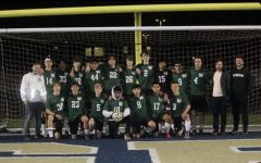 The boys soccer team poses for a team picture after their first and only game of last season. The players are excited for the chance to have a season.