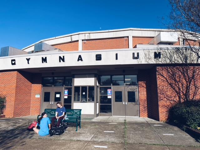 Two students sit outside of White Station High School. Shelby County Schools (SCS) announced the option to return to in-person school for students.